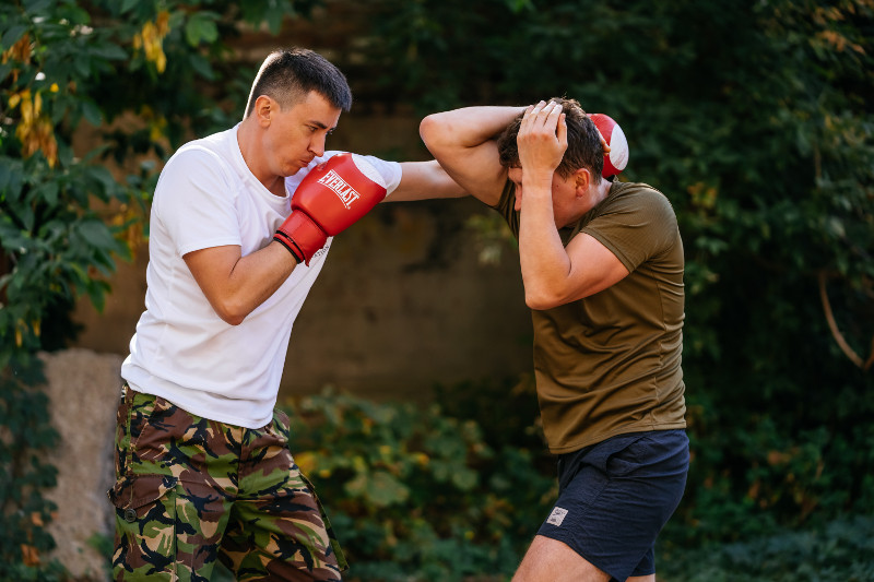 defence against punches using elbows and covering during krav maga exam